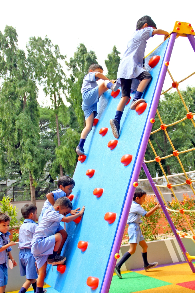 Pre-Primary Kids on Climbing Wall at School Playground.