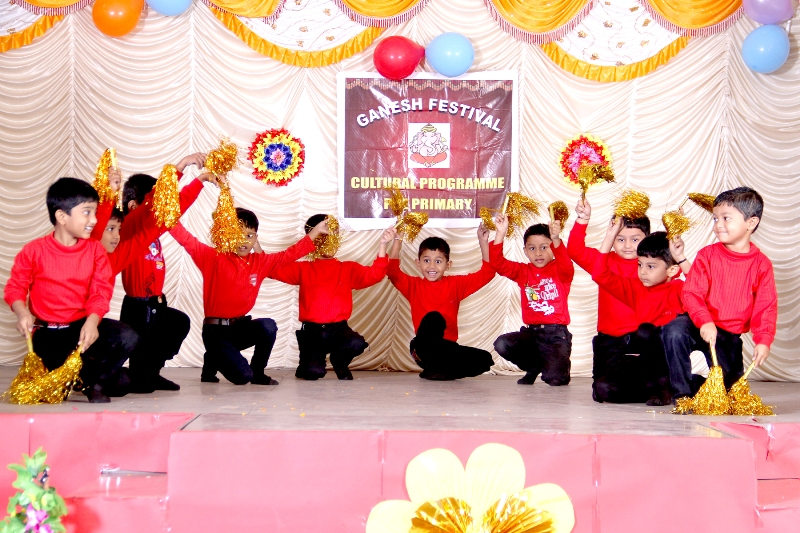 Ganesh Festival : Kids giving a bubbly performance with props.