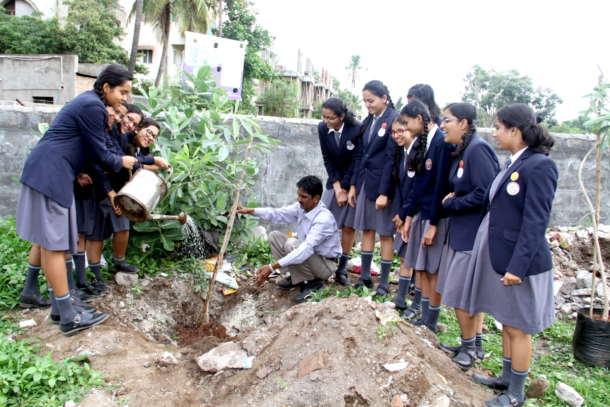 P. T. Instructor, Mr. Jagtap enjoying planting of a sapling.