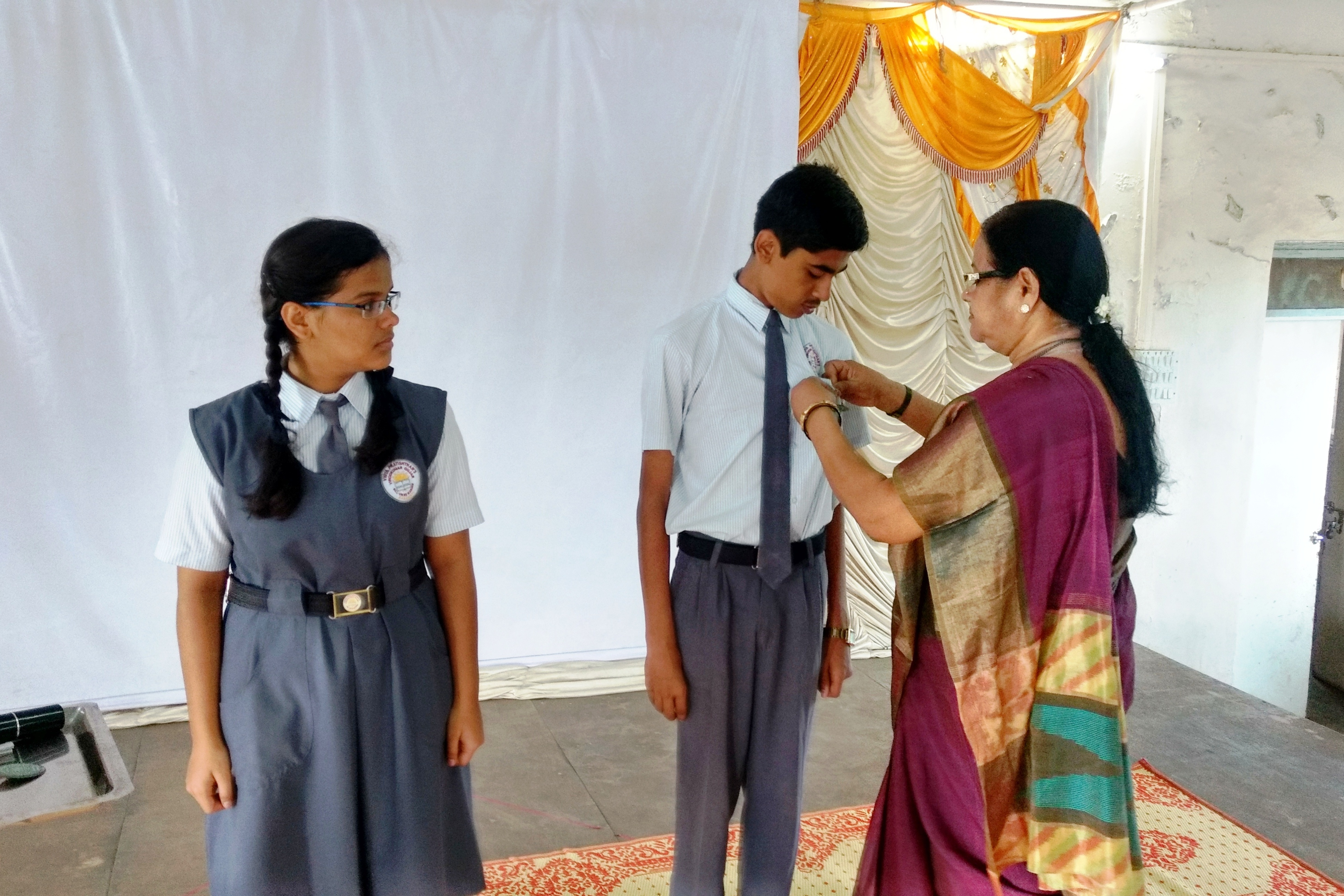 Investiture Ceremony : Principal Mrs. C. S. Rai giving the Badge to the School Captains