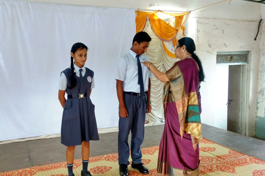 Investiture Ceremony : Principal Mrs. C. S. Rai giving the Badge to the School Vice Captains