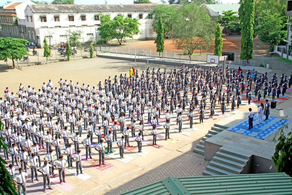 Students performing Yoga on International Yoga Day.